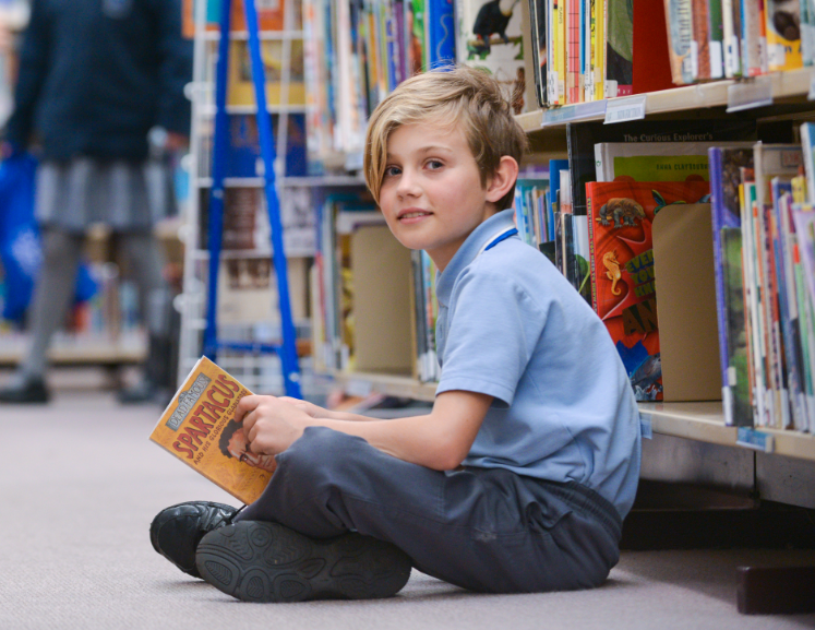 boy student in the library